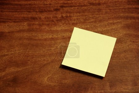 Photo for Yellow sticky memo note on wooden background - Royalty Free Image
