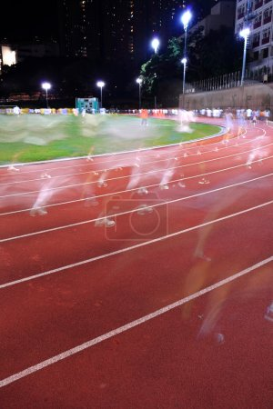 Photo for Running tracks in a stadium, with human running blur - Royalty Free Image