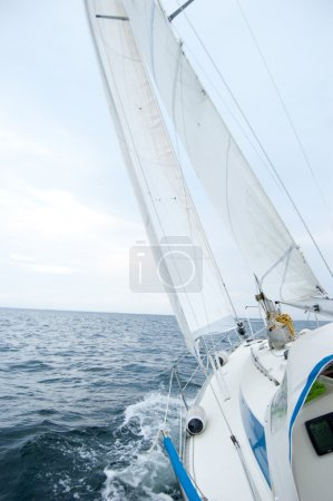 Sailing boat on sunny windy day