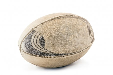 A well used and worn rugby ball. Isolated on white...
