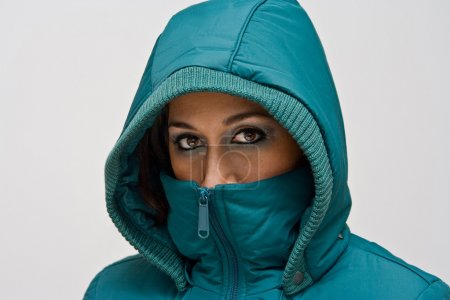 Young woman with green hood