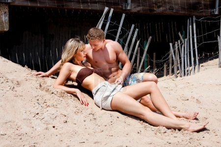 Couple laying in sand