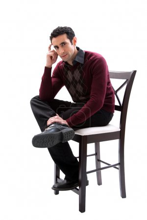 Handsome business guy sitting on chair