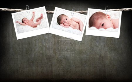 Cute baby photos hanging on rope