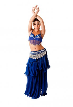 Photo for Beautiful Arabic belly dancer harem woman in blue with silver dress and head jewelry with gem dancing arms in air, isolated. - Royalty Free Image