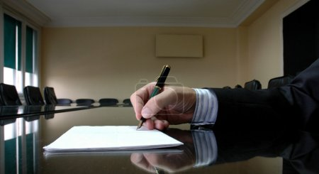 Photo for Business Manager writing on blank paper, business concept - Royalty Free Image