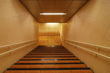 Photo for Light corridor with stairs going down - Royalty Free Image