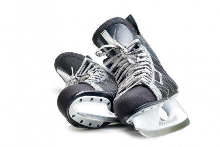 Photo pour Des patins de hockey pour hommes. Isolé sur fond blanc . - image libre de droit