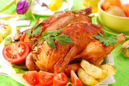 Photo for Roasted chicken stuffed with liver and parsley for easter dinner - Royalty Free Image