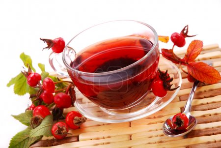 Cup of rosehip tea izolated on white...
