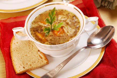 Traditional polish tripe soup with vegetables in w...