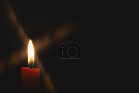 Photo for Closeup of burning candle on black background - Royalty Free Image