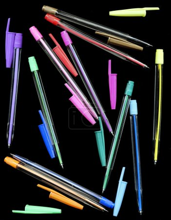 Colourful pens on a black background