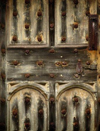 Old rusty wooden gothic door detail