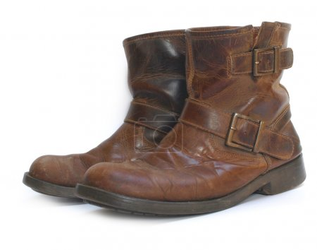 A pair of old brown leather worn out wor