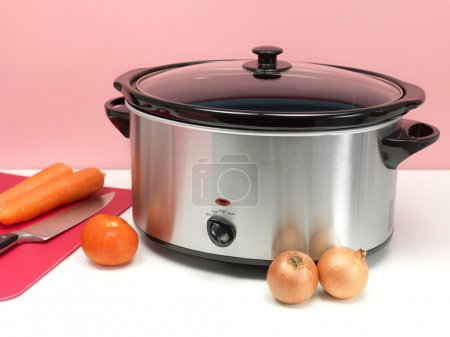 Photo for An electric slow cooker on a kitchen bench - Royalty Free Image