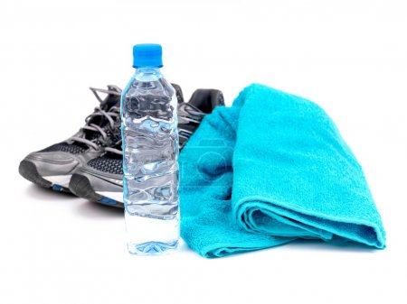 Photo for A bottle of water, joggers and a sports towel isolated against a white background - Royalty Free Image