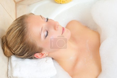 Blond woman in bath