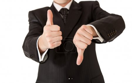 Business man in suit thumbs up and down on white isolated backgr