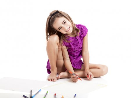 Photo for Girl sitting on floor and making drawings on paper - Royalty Free Image