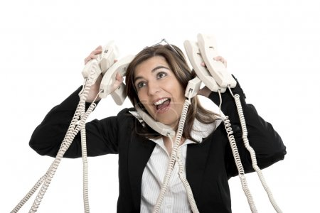 Foto de Mujer ocupada trabajando y responder un montón de llamadas al mismo tiempo - Imagen libre de derechos