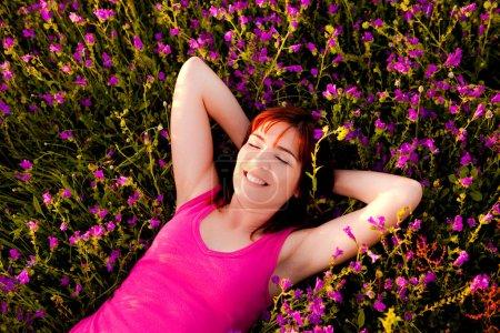 Lying on flowers