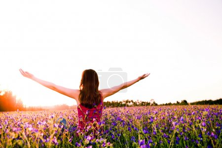 Photo for Free girl enjoying the nature on a beautiful flowery field - Royalty Free Image