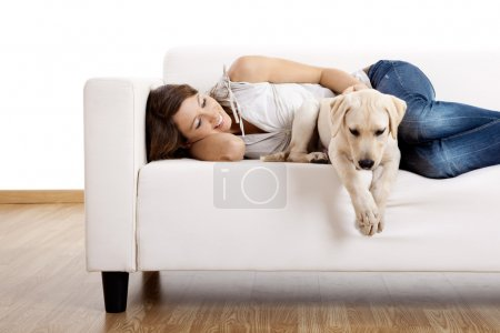 Photo for Young beautiful woman at home with her cute dog - Royalty Free Image