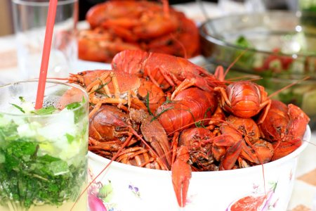 Boiled crayfish and mojito cocktail
