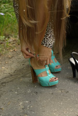 Girl put on shoes