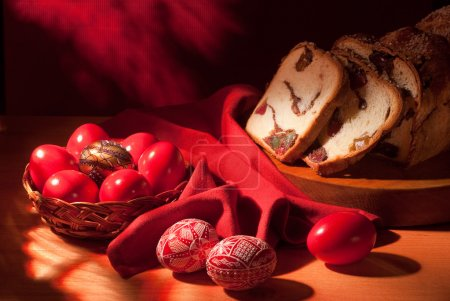 Photo for Handmade Romanian wax decorated Easter eggs and traditional cake composition - Royalty Free Image