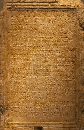 Photo for Latin words carved into ancient weathered stone wall - Royalty Free Image
