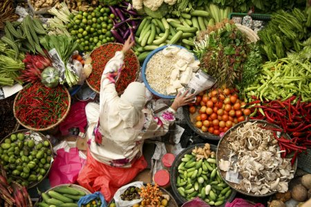 Muslim woman selling fresh vegetables at market in kota baru malaysia