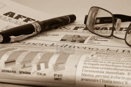 Glassess and pen on financial newspaper
