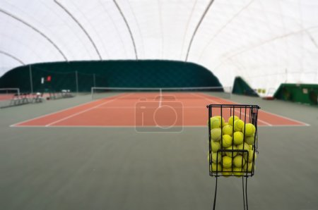 Photo for View on tennis court with full basket of tennis ball - Royalty Free Image