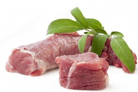 Photo for A market fresh raw pork tenderloin with Sage Isolated on White - Royalty Free Image