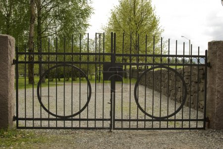 Photo for The old black wrought iron cemetery gate. - Royalty Free Image