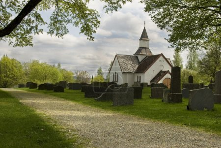 Old cemetery with white Church