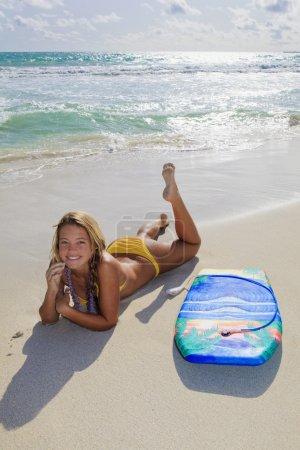 Beautiful teenage girl with boogieboard