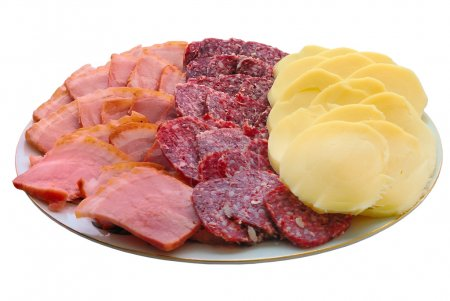 Piece of smoked meat and cheese