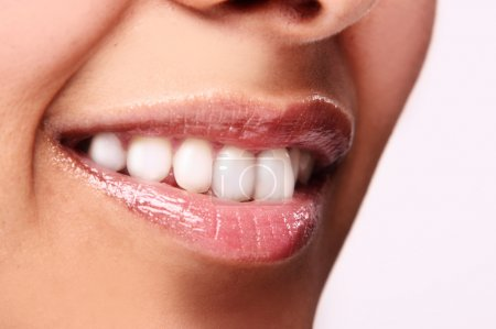 Photo for Smiling woman mouth with great teeth. Over white background - Royalty Free Image