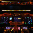 Instrument panel of a modern airliner at night (Bo...