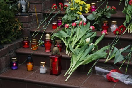 Photo for Funeral flowers and candles on the stairs - Royalty Free Image