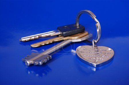 Bunch of keys on blue background