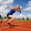 Track athlete exploding out of the starting blocks...