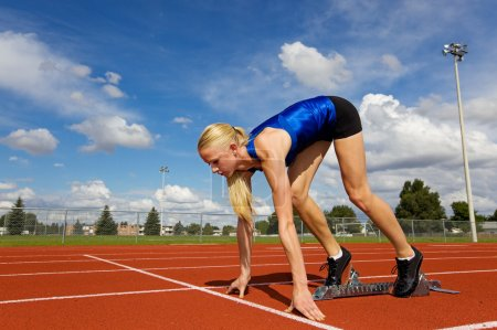 Photo for Young athlete on the starting blocks ready to race - Royalty Free Image
