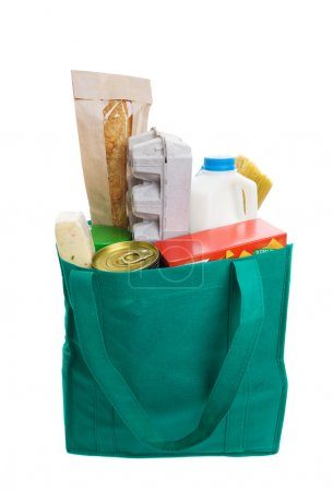 Photo for Green eco friendly grocery bag full of food - Royalty Free Image