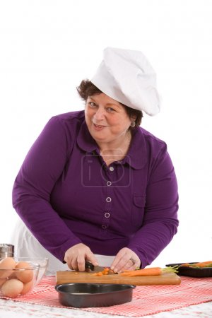 Photo for Female chef preparing the carrots in the kitchen - Royalty Free Image