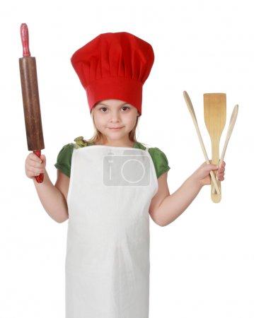 Photo pour Petite fille mignonne portant un chapeau de cuisinier en chef rouge, isolée sur blanc - image libre de droit