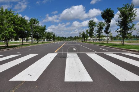 Zebra walk way traffic symbol as blue sky